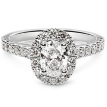 oval cut diamond engagement ring with halo and diamond shoulders
