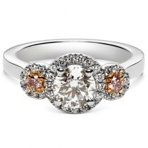 round brilliant cut diamond trilogy ring with argyle pink side stones